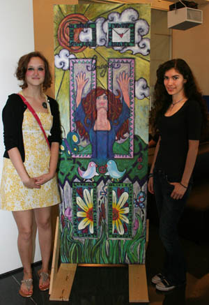 "Mary Reeves and Saharra Rangel of Davenport Central High with their door, which encouraged victims of domestic abuse to ""Imagine"" a better life."